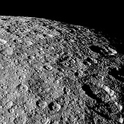 Cassini looks over the heavily cratered surface of Rhea during the spacecraft's flyby of the moon on March 10, 2012.