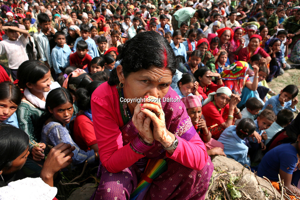 A woman sits at a Maoist rally in a remote part of western Nepal on June 22, 2006. The ten-year old Maoist uprising in Nepal has claimed an estimated 13,000 lives. (Photo/Scott Dalton)
