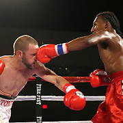 Leonardo Kenon (R) connects on a punch to the nose of Tommy Bryant during a Fire Fist Boxing Promotions boxing match at the A La Carte Pavilion on Saturday, August 12 , 2017 in Tampa, Florida.  (Alex Menendez via AP)