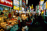 Koreans eating at street food stalls in the Sonmyon district of Pusan (Busan), South Korea