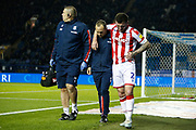 Thomas Edwards of Stoke City goes off with an injury during the EFL Sky Bet Championship match between Sheffield Wednesday and Stoke City at Hillsborough, Sheffield, England on 22 October 2019.
