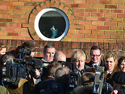 © Licensed to London News Pictures. 20/02/2013. Eastleigh, UK Boris Johnson is interviewed by media on the outside a property on the street. London Mayor and member of the Conservative Party, Boris Johnson, and Conservative Candidate Maria Hutchins campaigning in the Eastleigh By-Election today 20th February in Stamford way, Eastleigh. Photo credit : Stephen Simpson/LNP