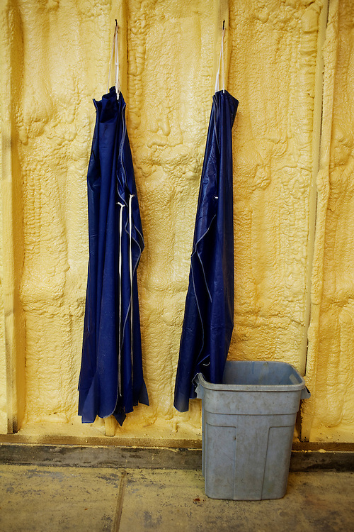 Aprons hang from hooks in the room where skins are graded and salted before being shipped at Daneco Alligator Farm in Houma, Louisiana on Friday, February 19, 2010.