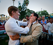 L-R. Dustin Lance Black, an American screenwriter, director, film and television producer, and LGBT rights activist, embraces a Paul Katami, one of the plaintiffs against Prop. 8 during a rally after Prop. 8 was overturned.