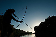 Fishing with bow and arrow<br />