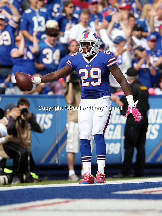 Buffalo Bills running back Karlos Williams (29) celebrates after catching a 23 yard touchdown pass that cuts the New York Giants lead to 16-10 in the fourth quarter during the 2015 NFL week 4 regular season football game against the New York Giants on Sunday, Oct. 4, 2015 in Orchard Park, N.Y. The Giants won the game 24-10. (©Paul Anthony Spinelli)