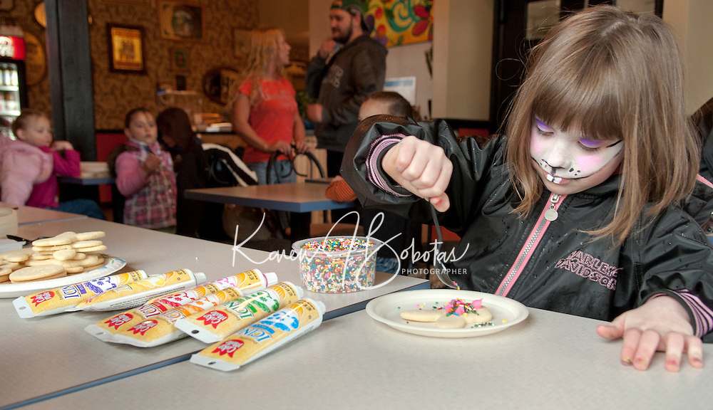 6 year old Jerikah Sylvia enjoys the Laconia Easter Eggstravaganza Saturday afternoon including the Egg Hunt at Rotary Park, a visit to the Evangelical Baptist Church for face painting and a stop at Burrito Me to decorate a bunny cookie.  (Karen Bobotas/for the Laconia Daily Sun)