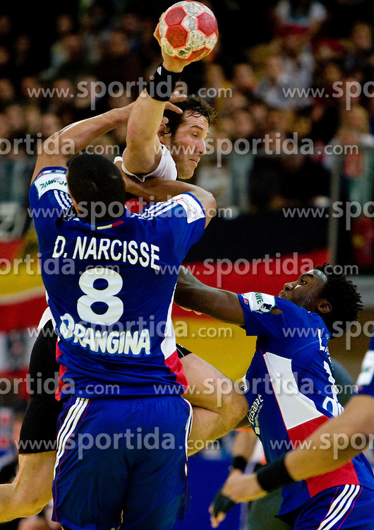 Torsten Jansen of Germany vs Daniel Narcisse of France and Luc Abalo of France during the Men's Handball European Championship Main Round match between Germany and France at the Olympia Hall on January 24, 2009 in Innsbruck, Austria. (Photo by Vid Ponikvar / Sportida) - on January 2010
