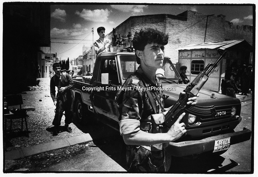 ERBIL, KURDISTAN, IRAQ, JULY 1994. Fighters of the KDP patrol the streets of Erbil. Erbil is the stage of peace efforts between the warring factions of the KDP and PUK factions. ©Photo by Frits Meyst/NewsImages