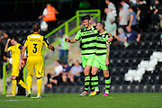 Goal heroes Kieffer Moore (14) of Forset Green Rovers and Rhys Murphy (39) of Forset Green Rovers go to shake hand with Neil Ashton of Southport  at the end of the game in the Vanarama National League match between Forest Green Rovers and Southport at the New Lawn, Forest Green, United Kingdom on 29 August 2016. Photo by Graham Hunt.