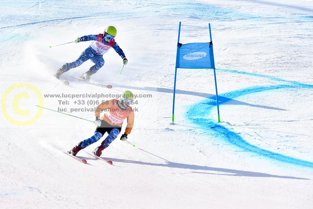 YANG Jae Rim B2 KOR Guide: KO Un So Ri competing in ParaSkiAlpin, Para Alpine Skiing, Super G at PyeongChang2018 Winter Paralympic Games, South Korea.
