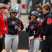 12 May 2018: San Diego State coaches Kathy Van Wyk and Stacey Nuveman Deniz talk with Zaria Meschack (2) and Iesha Hill (24) during a time out in the bottom of the seventh. San Diego State women's softball closed out the season against Utah State with a 4-3 win on seniors day and sweep the series. <br /> More game action at sdsuaztecphotos.com