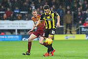 Burton Albion's Mason Bennett is first to the ball ahead of Bradford City defender Stephen Darby during the Sky Bet League 1 match between Burton Albion and Bradford City at the Pirelli Stadium, Burton upon Trent, England on 6 February 2016. Photo by Aaron Lupton.