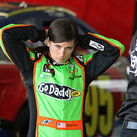 NASCAR Sprint Cup driver Danica Patrick pulls her hair back in the garage area, during a NASCAR Daytona 500 practice session at Daytona International Speedway on Wednesday, February 20, 2013 in Daytona Beach, Florida.  (AP Photo/Alex Menendez)