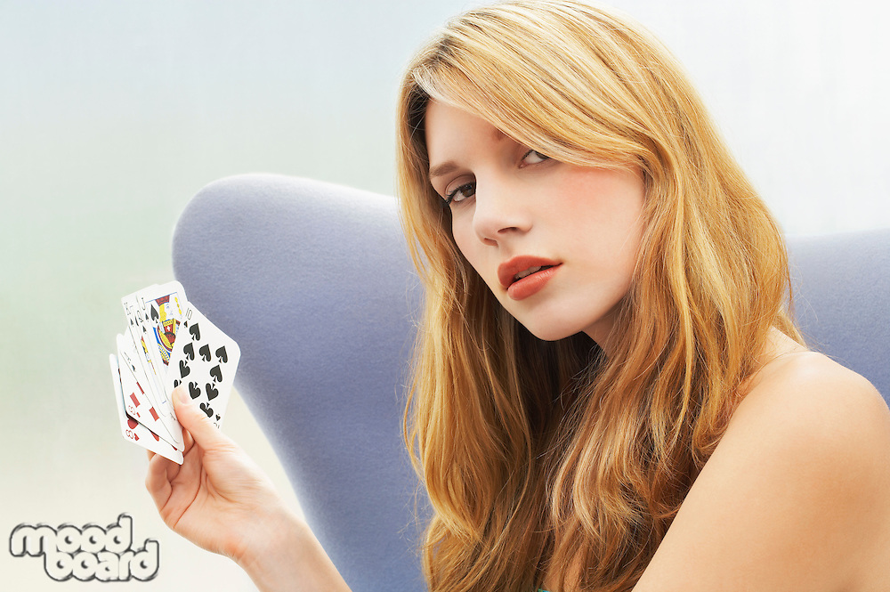 Woman sitting Playing Cards portrait