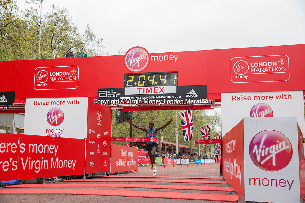 Eliud Kipchoge of Kenya crosses the line to finish first in the Elite Men's race at the Virgin Money London Marathon, Sunday 26th April 2015.<br /> <br /> Scott Heavey for Virgin Money London Marathon<br /> <br /> For more information please contact Penny Dain at pennyd@london-marathon.co.uk