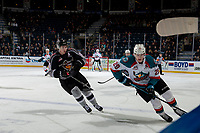 KELOWNA, CANADA - FEBRUARY 16:  Owen Hardy #15 of the Vancouver Giants checks Nolan Foote #29 of the Kelowna Rockets as he skates with the puck past the bench on February 16, 2019 at Prospera Place in Kelowna, British Columbia, Canada.  (Photo by Marissa Baecker/Shoot the Breeze)
