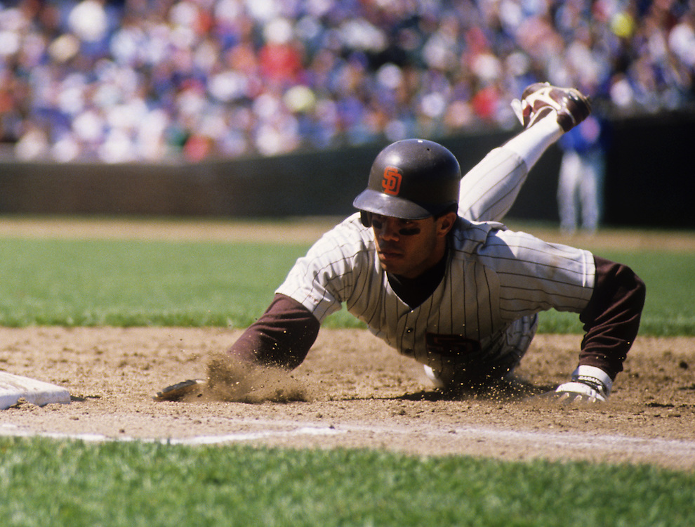 CHICAGO - 1990:  Roberto Alomar of the San Diego Padres dives back to first base against the Chicago Cubs during an MLB game at Wrigley Field in Chicago, Illinois.  Alomar played for the Padres from 1988-1990.  (Photo by Ron Vesely)