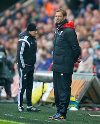 SWANSEA, WALES - Sunday, May 1, 2016: Liverpool's manager Jürgen Klopp smiling through the pain of a 3-1 defeat to Swansea City during the Premier League match at the Liberty Stadium. (Pic by David Rawcliffe/Propaganda)