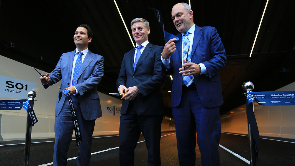 Prime Minister Bill English, centre, Minister of Transport Simon Bridges, left  and Finance Minister Steven Joyce officially cut the ribbon to mark the opening of the Waterview Connection between Pt Chevalier and Mt Roskill, Auckland, New Zealand, Sunday, June 18, 2017. Credit:SNPA / Hayden Woodward**NO ARCHIVING**