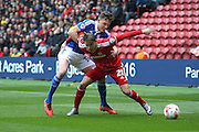 Middlesbrough midfielder, on loan from Southampton, Gaston Ramirez (21) held by Ipswich Town midfielder, on loan from Barnsley, Paul Digby (37)  during the Sky Bet Championship match between Middlesbrough and Ipswich Town at the Riverside Stadium, Middlesbrough, England on 23 April 2016. Photo by Simon Davies.