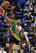 Feb. 21, 2012; Indianapolis, IN, USA; New Orleans Hornets small forward Trevor Ariza (1) shoots the ball as Indiana Pacers small forward Danny Granger (33) guards at Bankers Life Fieldhouse. Indiana defeated New Orleans 117-108. Mandatory credit: Michael Hickey-US PRESSWIRE