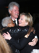 l to r: Former President Bill Clinton, U.S.Secretary of State Hillary Clinton and Guest at The Amsterdam News 100th Anniversary Gala held at the David H. Koch Theater at Lincoln Center on November 30, 2009 in New York City. © Terrance Jennings / Retna Ltd.
