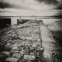 Beadnell Bay harbour wall with calm sea, Northumberland, UK