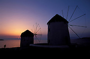 GREECE.The Cyclades:Mykonos.The famed windmills at sunset.