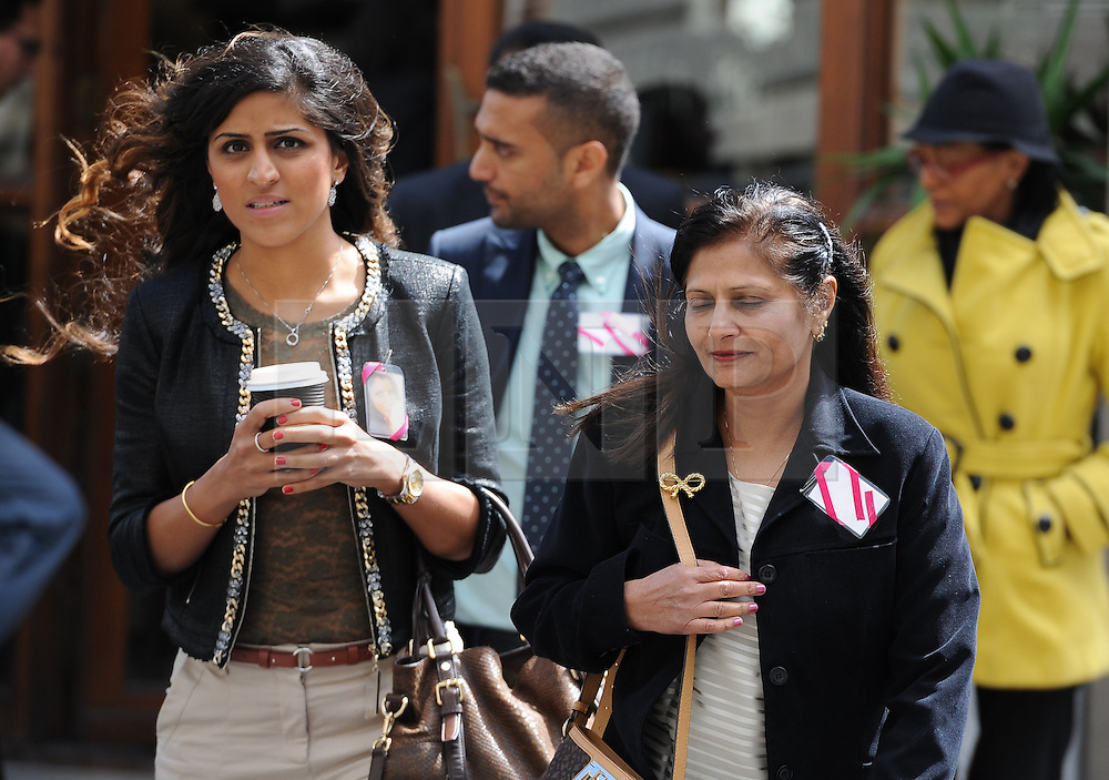 © Licensed to London News Pictures. 08/10/14. CAPE TOWN, SOUTH AFRICA -   Nishma Hindocha (cousin of Anni Dewani) and Anni's mother, Nilam Hindocha, leave court, during Day 3 of the Shrien Dewani trial at the Cape High Court before Judge Jeanette Traverso. Dewani is caused of hiring hit men to murder his wife, Anni. Anni Ninna Dewani (née Hindocha; 12 March 1982 – 13 November 2010) was a Swedish woman who, while on her honeymoon in South Africa, was kidnapped and then murdered in Gugulethu township near Cape Town on 13 November 2010. Photo credit : Roger Sedres/LNP