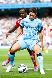Samir Nasri of Manchester City is challenged by Victor Moses of Stoke - Photo mandatory by-line: Rogan Thomson/JMP - 07966 386802 - 30/08/2014 - SPORT - FOOTBALL - Manchester, England - Etihad Stadium - Manchester City v Stoke City - Barclays Premier League.