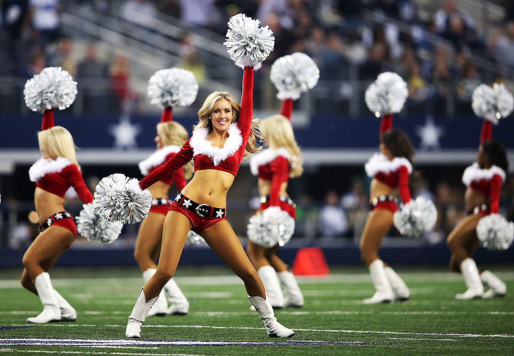 Dallas Cowboys cheerleaders cheer wearing their Christmas Holiday outfits during the Green Bay Packers against the Dallas Cowboys during a NFL game in Dallas, Texas Sunday, December, 15, 2013. (AP Photo/Tom Hauck)