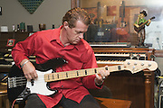 "Wise ""Doc"" Smith plays electric bass in the live recording room, Thursday, July 26, 2012, at Liquid Sound Studios in Greenville, Ind. (Photo by Brian Bohannon)"