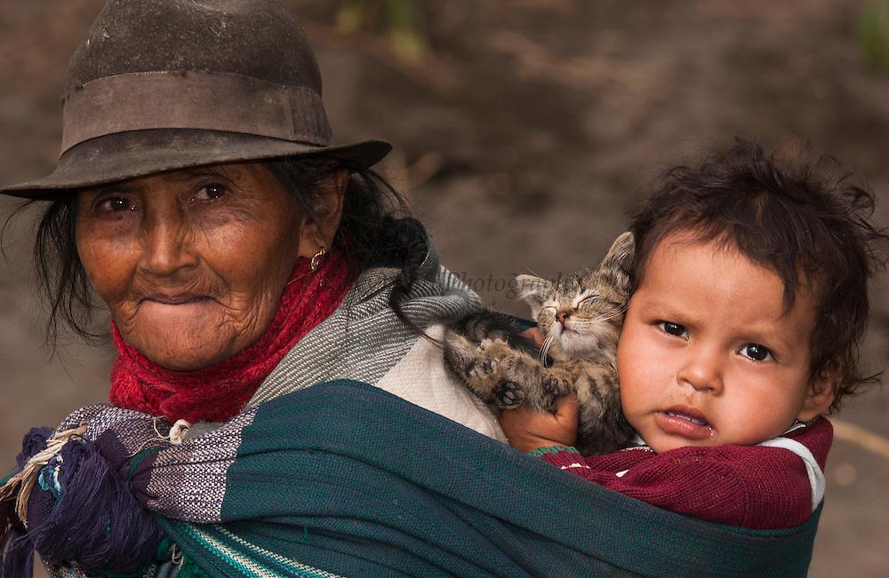 Maria Asoncion with Grandchild &amp; Cat<br /> Salasaca Indian<br /> Salasaca Village, near Ambato<br /> Andes<br /> ECUADOR.  South America<br /> Salasacha is well known for their original weaving designs