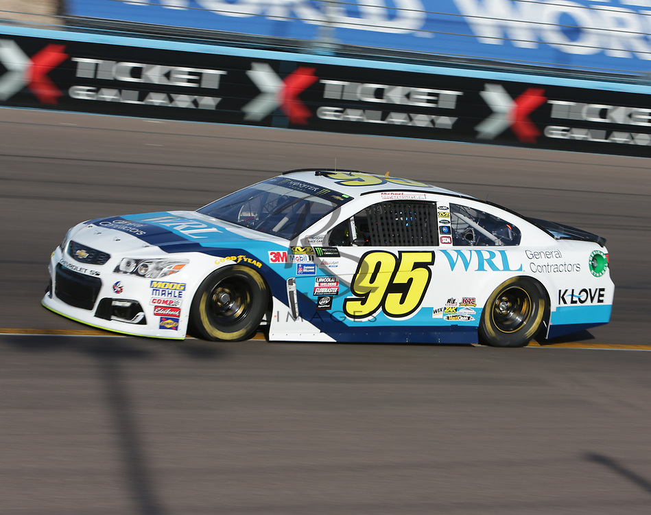 Michael McDowell qualifies for Sunday's NASCAR Cup Series auto race on Friday, March 17, 2017, in Avondale, Ariz.  (AP Photo/Rick Scuteri)