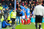 Portsmouth celebrate scoring the first goal against Bournemouth during the The FA Cup fourth round match between Portsmouth and Bournemouth at Fratton Park, Portsmouth, England on 30 January 2016. Photo by Graham Hunt.