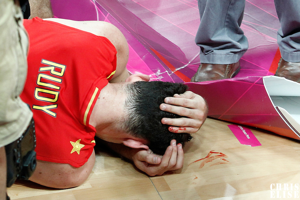 31 July 2012: Spain Rudy Fernandez lies down on the floor injured at the head during the first half of Spain vs Australia, during the men's basketball preliminary, at the Basketball Arena, in London, Great Britain.