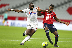 April 1, 2018 - Villeneuve D Ascq, France - Moussa Konate ( Amiens ) vs Kouadio Yves Dabila  (Credit Image: © Panoramic via ZUMA Press)