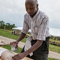 Chef Bashir Munye in the open-air kitchen at FarmStart's Harvest Table at McVean Farm, August 28, 2011.