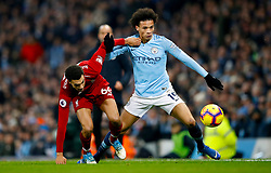 Liverpool's Trent Alexander-Arnold (left) and Manchester City's Leroy Sane battle for the ball during the Premier League match at the Etihad Stadium, Manchester.