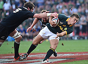 JOHANNESBURG, South Africa, 04 October 2014 : Handré Pollard of the Springboks, with his eyes focused on the try line gets past Sam Whitelock and Joe Moody of the All Blacks for his first try during the Castle Lager Rugby Championship test match between SOUTH AFRICA and NEW ZEALAND at ELLIS PARK in Johannesburg, South Africa on 04 October 2014. <br /> The Springboks won 27-25 but the All Blacks successfully defended the 2014 Championship trophy.<br /> <br /> © Anton de Villiers / SASPA
