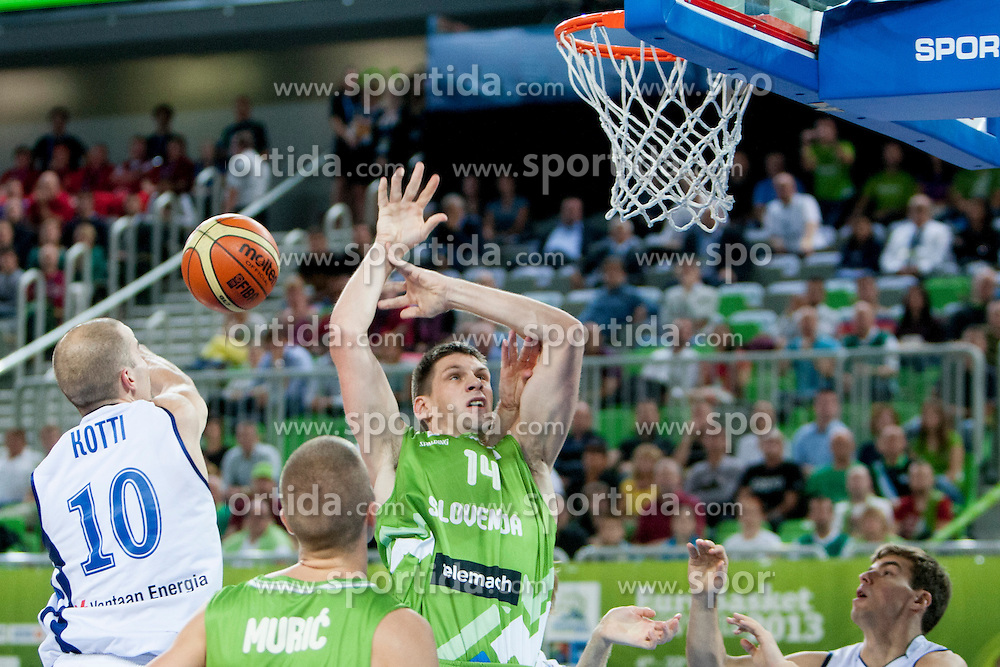 Tuukka Kotti #10 of Finland vs Gasper Vidmar of Slovenia during basketball match between National teams of Finland and Slovenia in 2nd Round at Day 13 of Eurobasket 2013 on September 14, 2013 in SRC Stozice, Ljubljana, Slovenia. (Photo By Urban Urbanc / Sportida)