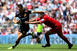 Henry Slade of Exeter Chiefs takes on Jamie George of Saracens - Mandatory by-line: Robbie Stephenson/JMP - 01/06/2019 - RUGBY - Twickenham Stadium - London, England - Exeter Chiefs v Saracens - Gallagher Premiership Rugby Final