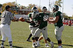 07 October 2006: Marcus Dunlop hands the ball to the umpire after scampering untouched to the end zone on a short run..The Titans of Illinois Wesleyan University started off strong with a touchdown on the 2nd play from scrimmage in the game.  The Titans led most of the way, but failed to maintain the lead in the 4th quarter giving up the decision of this CCIW conference game to the Red Men of Carthage by a score of 31 - 28. Action was at Wilder Field on the campus of Illinois Wesleyan University in Bloomington Illinois.<br />