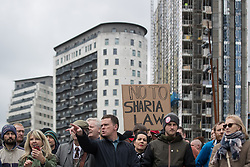 """© Licensed to London News Pictures . 24/03/2018. Birmingham, UK. """"No to Sharia Law """" placard . The Football Lads Alliance hold a demonstration against Islam and extremism in Birmingham City Centre . Offshoot group, The True Democratic Football Lads Alliance, also hold a separate demonstration . Photo credit: Joel Goodman/LNP"""