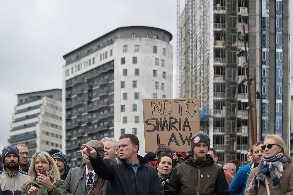 "© Licensed to London News Pictures . 24/03/2018. Birmingham, UK. ""No to Sharia Law "" placard . The Football Lads Alliance hold a demonstration against Islam and extremism in Birmingham City Centre . Offshoot group, The True Democratic Football Lads Alliance, also hold a separate demonstration . Photo credit: Joel Goodman/LNP"