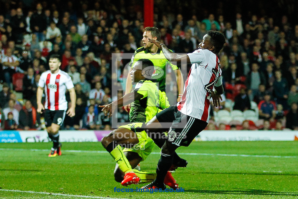 Josh Clarke of Brentford scores the opening goal during the Sky Bet Championship match between Brentford and Reading at Griffin Park, London<br /> Picture by Mark D Fuller/Focus Images Ltd +44 7774 216216<br /> 27/09/2016