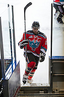 KELOWNA, CANADA - DECEMBER 5: Dylen McKinlay #19 of the Kelowna Rockets heads to the dressing room after warm up against the Swift Current Broncos at the Kelowna Rockets on December 5, 2012 at Prospera Place in Kelowna, British Columbia, Canada (Photo by Marissa Baecker/Shoot the Breeze) *** Local Caption *** Dylen McKinlay;