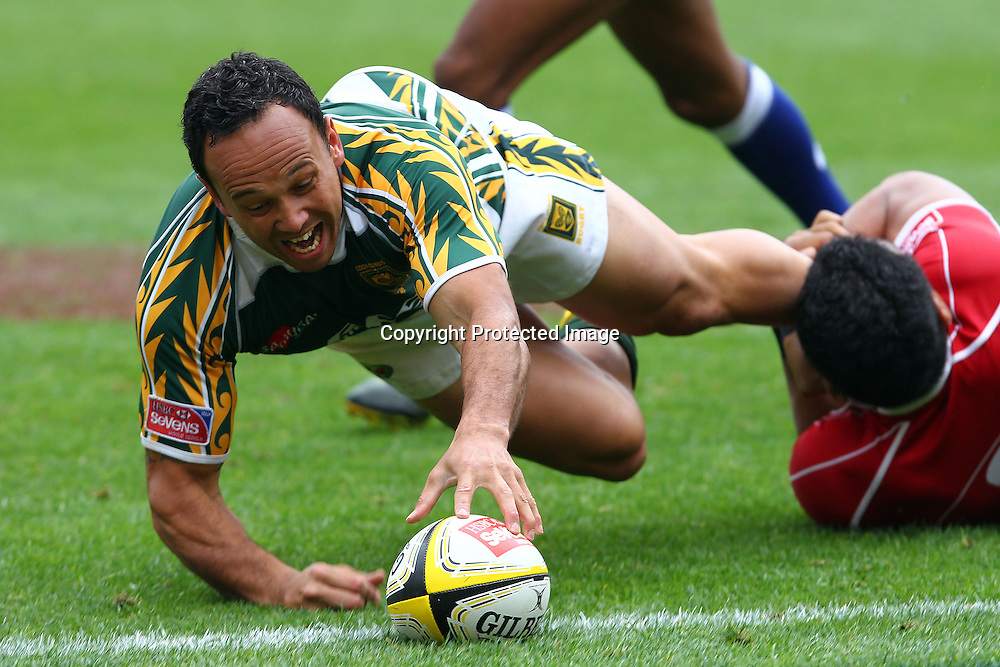 Cook Island's Jamie Makara dives over the line to score a try Costumed fans. Hertz Wellington Sevens - Day two at Westpac Stadium, Wellington, New Zealand on Saturday, 4 February 2012. Photo: Ella Brockelsby / photosport.co.nz