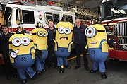 "The Minions visit FDNY at Engine 1 Ladder 24, Monday, Nov. 25, 2013, in New York, as part of the ""Minions in Manhattan"" tour to celebrate the release of ""Despicable Me 2"" on Digital HD on November 26 and Blu-ray and DVD on December 10.  The Minions took over Manhattan in preparation for their appearance in the 84th annual Macy's Thanksgiving Day Parade.  (Photo by Diane Bondareff/Invision for Universal Studios Home Entertainment/AP Images)"
